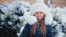 Attractive Girl In a Winter Snowy Day GIF