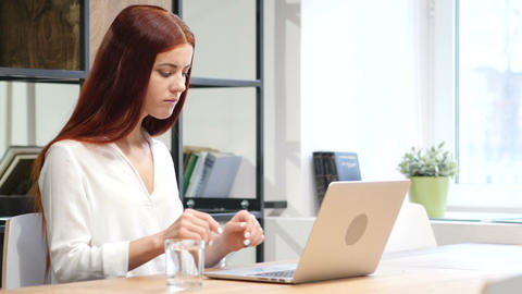 Woman Working on Laptop in Office Live Action