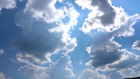 Slow motion of cumulus clouds. The sun. Beautiful sunny blue sky with bright sun Live Action
