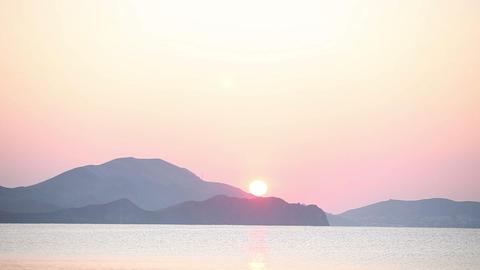 Sunrise at sea beach and mountains Footage
