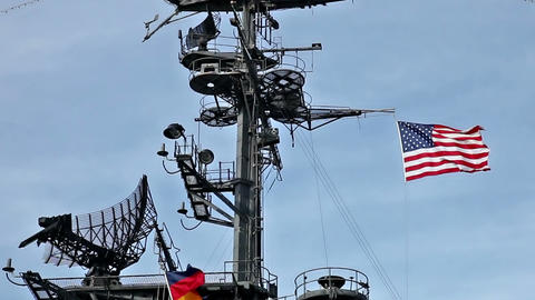 USA Flag And Antennas On Carrier Control Tower In Blue Sky stock footage