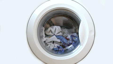 Washing machine full of clothes Stock Video Footage