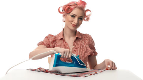 beautiful portrait of pin-up girls housewife with iron Stock Video Footage