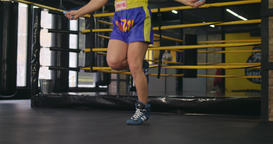 Boxer legs jumping rope near boxing ring 4k video. Sport skipping training Footage