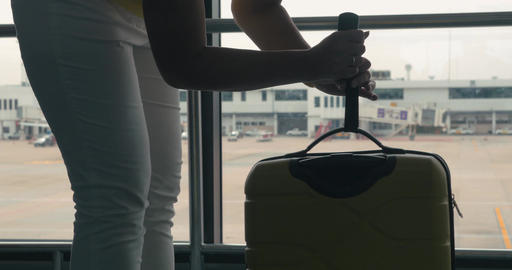 Young girl in Bangkok, Thailand at the airport weighing the suitcase with luggag Footage