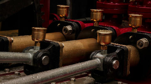 Ultra closeup view of three pistons of an outdoor hydraulic engine Footage