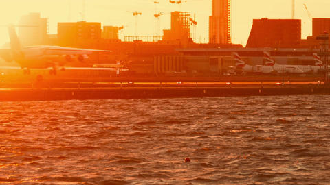 London City Airport - Closeup shot showing a sunset landing of a short-haul airl Footage