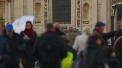 Closeup shot of a cross-generation crowd crossing the Millennium Bridge in Londo Footage