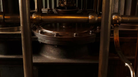 Closeup tilting shot if a large industrial hydraulic single cylinder beam engine ビデオ