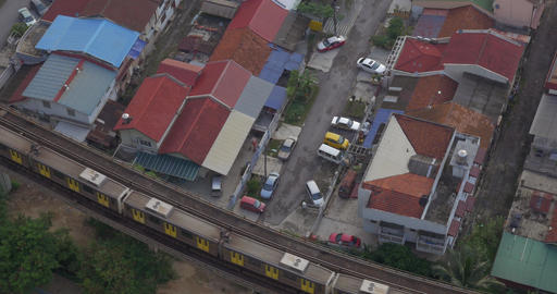 Buildings and railway with a passing train in city of Kuala Lumpur, Malaysia Footage