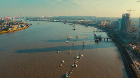 Wide angle aerial shot of the river Thames and North Greenwich peninsula in Lond Footage