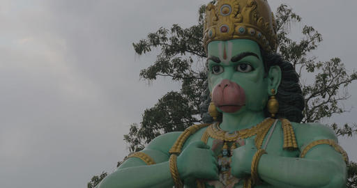 Seen head with hands of statue of Hanuman at Batu Caves, Malaysia Footage