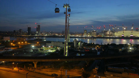 Blue hour aerial shot showing the Greenwich peninsula and the cable car transpor Footage