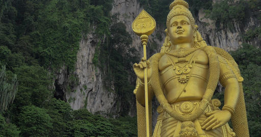Murugan statue against limestone hill. Batu Caves, Malaysia Footage