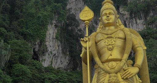 Murugan statue against limestone hill. Batu Caves, Malaysia Footage