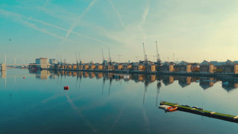 Aerial view of East London docklands and the Thames on a day of a clear blue sky Footage