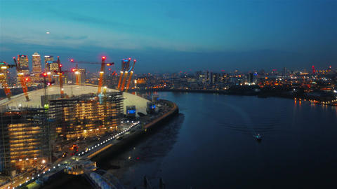 Early evening aerial shot featuring the North Greenwich peninsula and the Canary