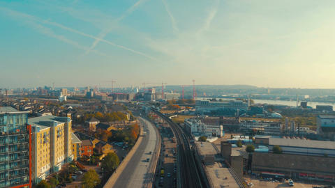 Wide angle aerial view of the dockyards, highways and industrial developments in Footage