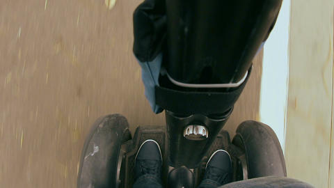 Man riding on a Segway in the park Footage