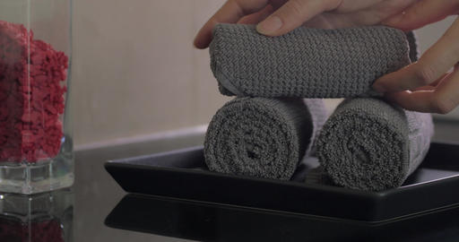 Close up view of woman hand putting on plate rolls of towels Footage