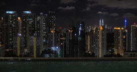 From pool on roof of a hotel in Kuala Lumpur, Malaysia seen night city Footage