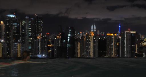 In Kuala Lumpur, Malaysia seen night city with Petronas twin towers and skyscrap Footage