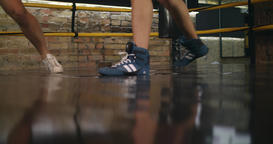 Two boxers sparring training in boxing ring 4k close-up video. Legs foot floor Footage