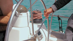 Man controls the steering wheel of a sailing boat Footage