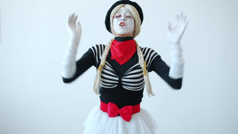 Female pantomimist in costume sneezing rubbing nose feeling sick on white color Live Action