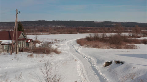 Russian road in the winter. Winter road in the village. Winter landscape in the Live Action