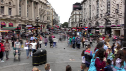 Time lapse. Piccadilly Circus. By walking the sidewalks people and cars go down  Footage