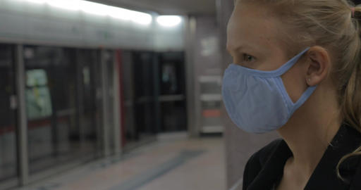 Woman putting on mask in the subway Footage