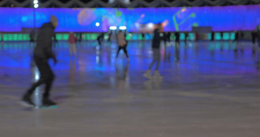 People on skating-rink at night Footage