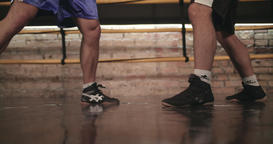 Two boxers sparring training in boxing ring 4k video. Close-up view of legs foot Footage