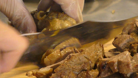 Cutting cooked meat Footage