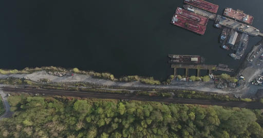 Aerial top down view of forest and shipyard for tugboats Footage
