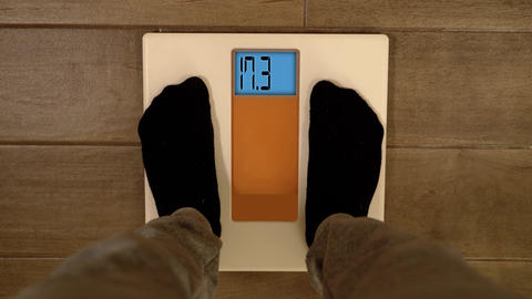 Person feet step on floor electronic scales and digits run ライブ動画