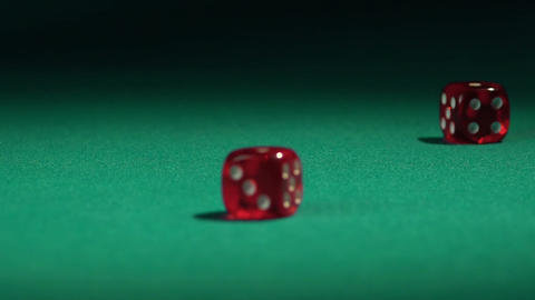 Closeup of dice falling on green casino table, betting on huge amount of money Footage