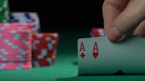 Poker player holding one pair of aces, good combination. Chances of winning Footage