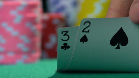 Person having bad combination in poker, weak hand. Losing money, bankruptcy Footage