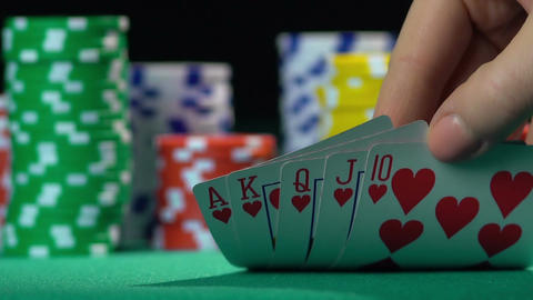 Successful poker player holding royal flush card combination. Leader, winner Footage