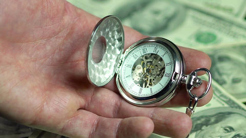 Time and money, human life passing by in pursuit of wealth. Pocket watch closeup Footage