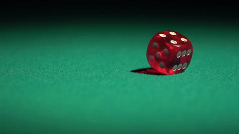 Slow-motion video of gambling game, red dice falling on green casino table Footage