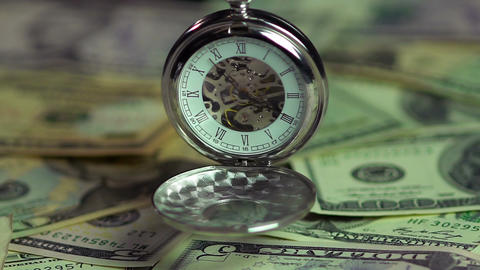 Watch and money closeup, the pendulum of fate. Importance of time over finances Footage