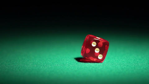 Person throwing red dice on the table, beautiful background for online casino Footage