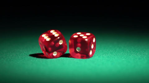 Macro view of red casino dice rolling on table, success and luck in human life Footage