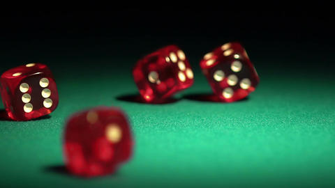 Multiple red dice rolling on green table. Beautiful casino background, gambling Footage