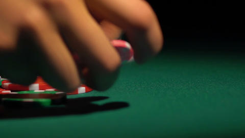 Close-up shot of female hands collecting poker chips off the table at casino Footage