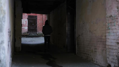 Teenager wandering alone in strange place, depressed young man walking slowly Footage