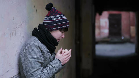 Depressed guy suffering from cold and loneliness in strange abandoned place Footage